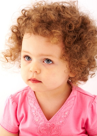 Portrait of small girl looking aside with serene expression photo