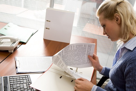 Pretty secretary working with papers in office Stock Photo - 9163306