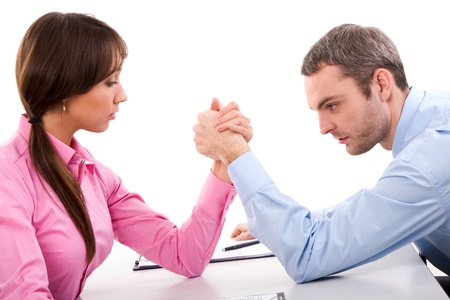 Man and woman in arm wrestling gesture on working table during meeting Stock Photo - 9163065