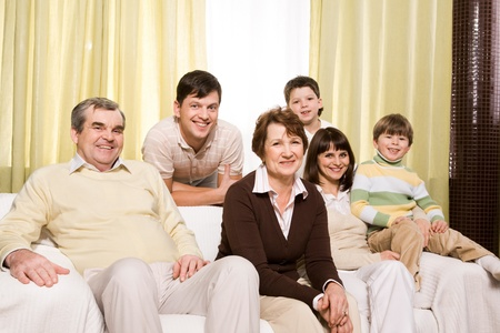 Portrait of senior and young couples with their children looking at camera at home Stock Photo - 9164343