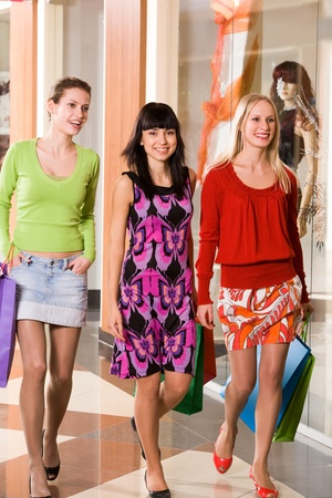 Photo of happy girls walking down trade center during shopping Stock Photo - 9163451