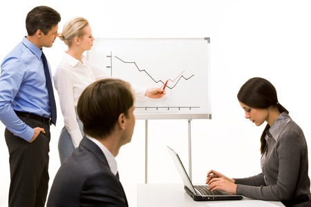 Image of business partners getting ready for report at working meeting photo