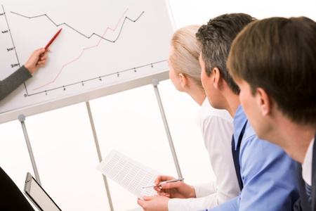 Image of business partners listening to report at working meeting Stock Photo - 9164399