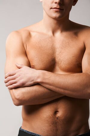 Image of shirtless man crossing his arms on chest photo