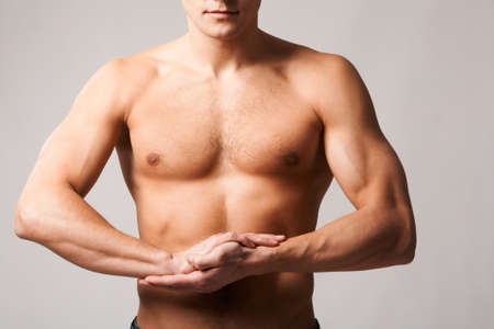 male parts: Image of shirtless man keeping his arms by chest Stock Photo
