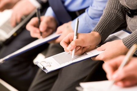 Close-up of human hands with pens over business documents Stock Photo - 9163425