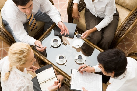Close �up of conversation of confident businesspeople in the room  photo