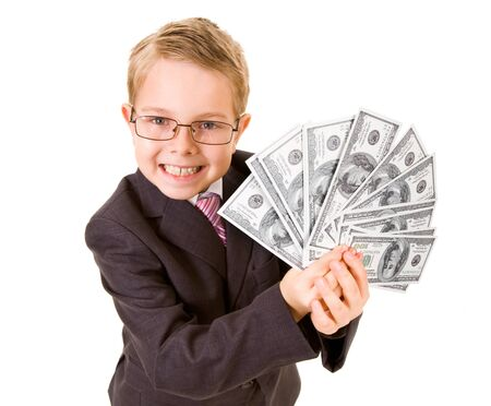 wealthy lifestyle: Portrait of happy boy with dollar bills looking at camera