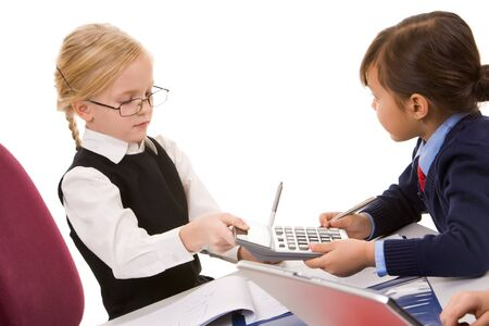 Photo of smart girl giving calculator to her friend Stock Photo - 9163372