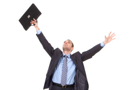 successful: Portrait of successful businessman with briefcase in hand