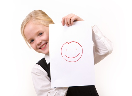Portrait of pretty girl with drawing of happy face looking at camera photo