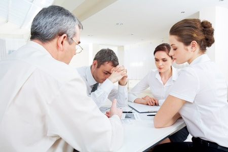 Portrait of business people deciding problems of project at meeting  photo