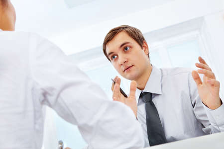 Smart businessman explaining something to his colleague in office Stock Photo - 9164237