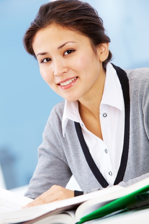 Portrait of smiling businesswoman looking at camera  photo