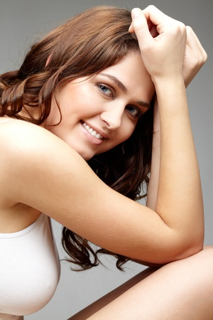 Portrait of feminine woman looking at camera with smile photo