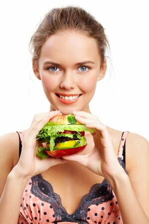 vegetarian hamburger: Portrait of pretty young girl with vegetable burger in hands