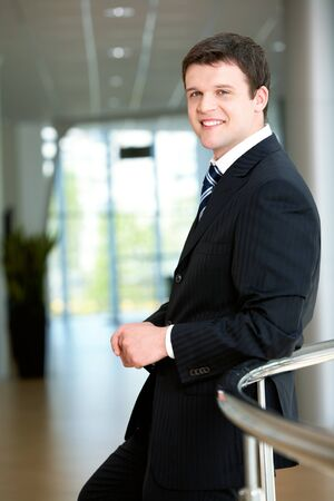 competitive: Portrait of attractive male in suit looking at camera