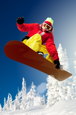 Portrait of snowboarder doing extreme trick photo