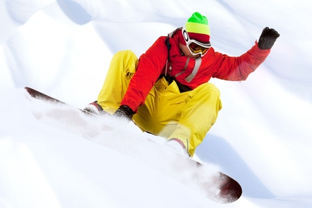 Image of snowboarder with holding his board during skating down photo