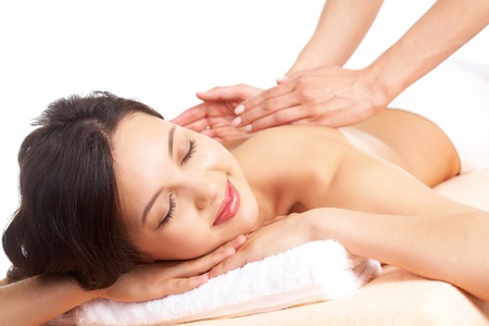 Portrait of young female enjoying the procedure of massage photo