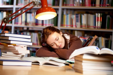 Portrait of student sleeping in university library photo
