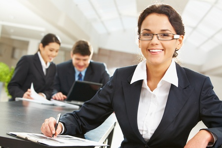 Portrait of happy leader with two companions planning work at background photo