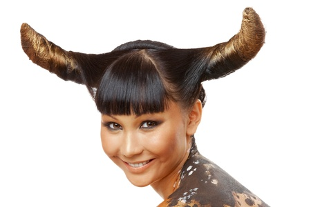 Portrait of female with horns looking at camera photo