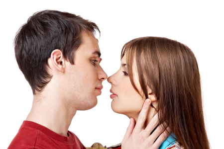 Profiles of amorous man and woman looking at each other with passion photo