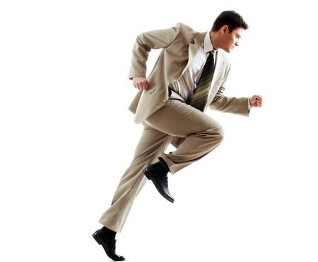 businessman running: Portrait of running businessman against white background