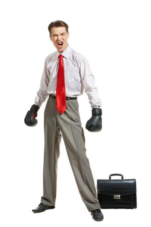 Portrait of aggressive businessman in boxing gloves over white background photo