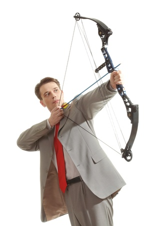 concentrated: Portrait of concentrated male with crossbow in hands over white background Stock Photo