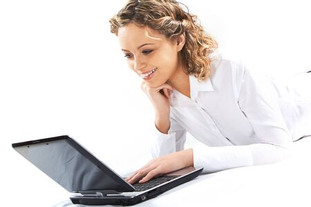 using a laptop: Portrait of pretty student using laptop for finding information Stock Photo
