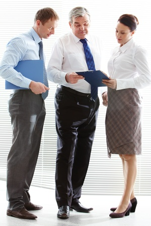 discussing: Image of confident colleagues sharing ideas at meeting