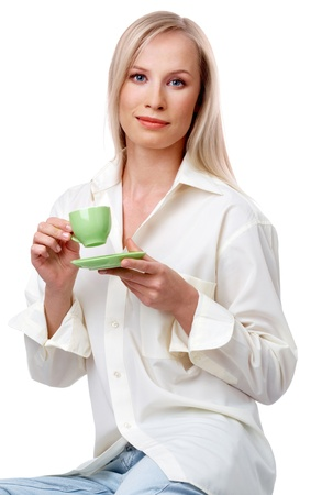 Beautiful blonde with cup of coffee looking at camera over white background Stock Photo - 9210986