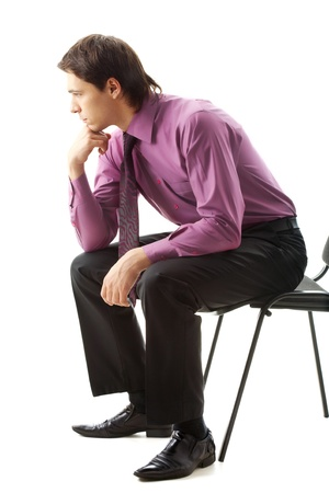 people sitting: Portrait of pensive businessman sitting on chair Stock Photo