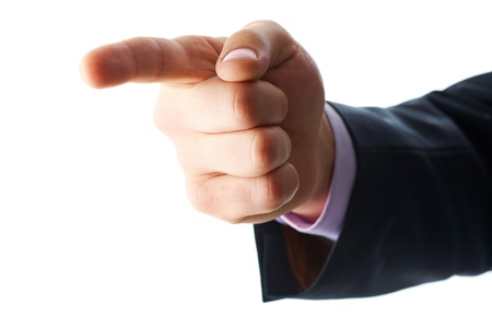 dictatorial: Photo of human hand with forefinger pointing aside  Stock Photo