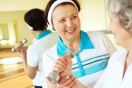 amiable: Portrait of aged women interacting in sport gym Stock Photo