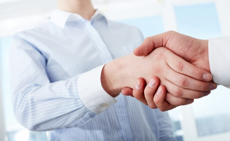 handskakning: Photo of handshake of business partners after striking deal