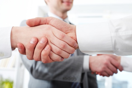 Photo of two pairs of partners arms handshaking after striking deal  photo