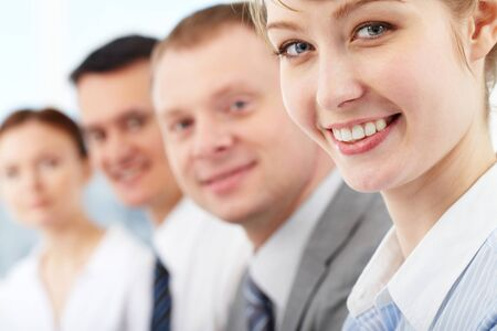 Portrait of friendly leader looking at camera with three employees behind Stock Photo - 9258463