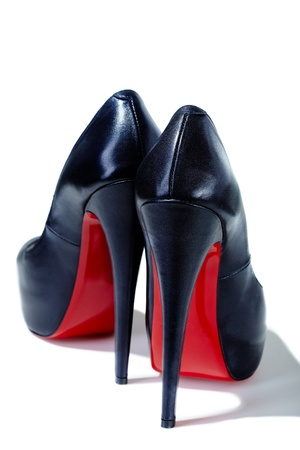 high heel shoes: Close-up of female high-heeled shoes over white background