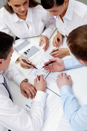 Image of business team during discussion of business papers Stock Photo - 9262960