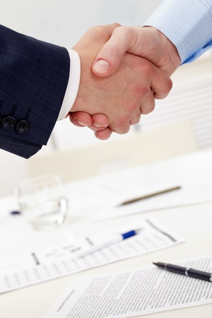 Photo of handshake of business partners after striking deal Stock Photo - 9262265