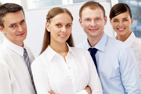 A business team of four looking at camera and smiling  Stock Photo - 9262988