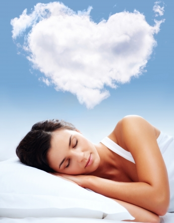 cushion: Portrait of a young girl sleeping on a pillow with heartshaped cloud over her