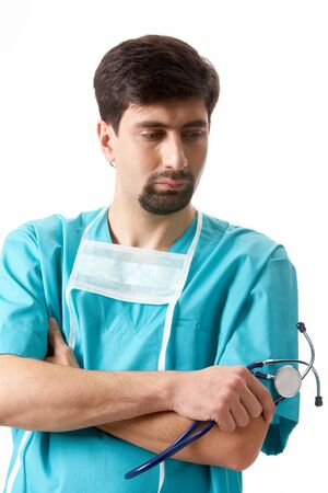Portrait of confident doctor with stethoscope in hand looking aside Stock Photo - 9262253
