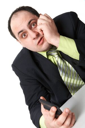 Photo of astonished businessman with some device in hand looking at camera Stock Photo - 9263145