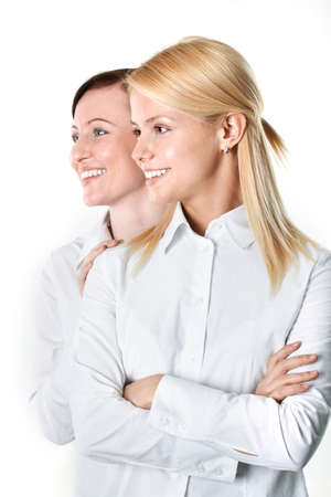 Profile of two smiling businesswomen standing together Stock Photo - 9263150
