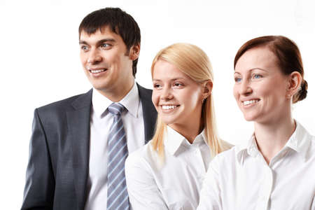 Three confident business people smiling and looking away isolated on white  Stock Photo - 9263180