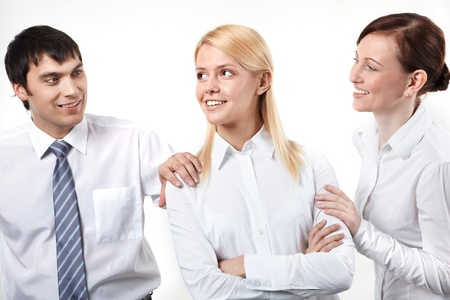 Two business people patting his colleagues on shoulder Stock Photo - 9263153